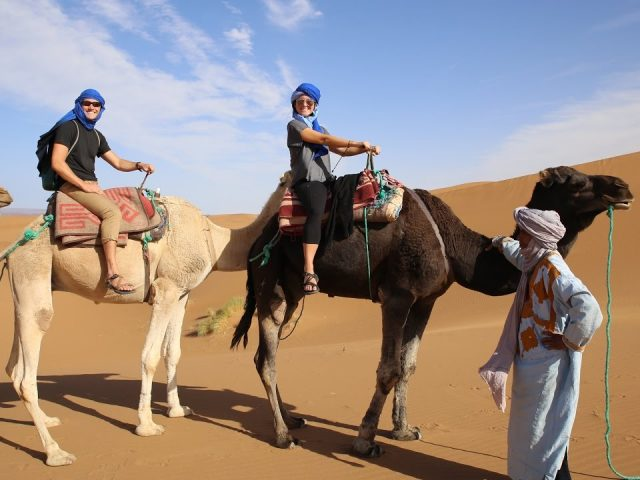 Riding camels through the Sahara